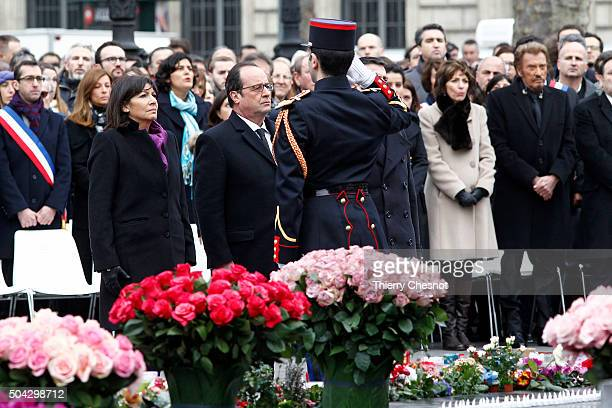 Paris Mayor Anne Hidalgo French President Francois Hollande French minister for Social Affairs Marisol Touraine and French singer Johnny Hallyday pay...