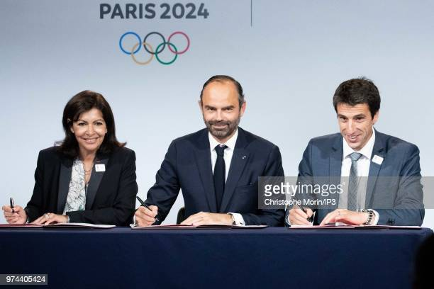 Paris Mayor Anne Hidalgo French Prime Minister Edouard Philippe and Tony Estanguet President of Paris 2024 attend the ceremony of signing of joint...