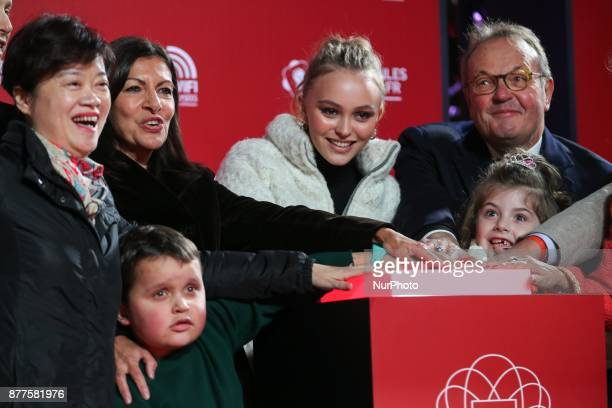 Paris Mayor Anne Hidalgo FrenchAmerican actress and model LilyRose Depp the president of the ChampsElysees Committee JeanNoel Reinhardt and the Mayor...