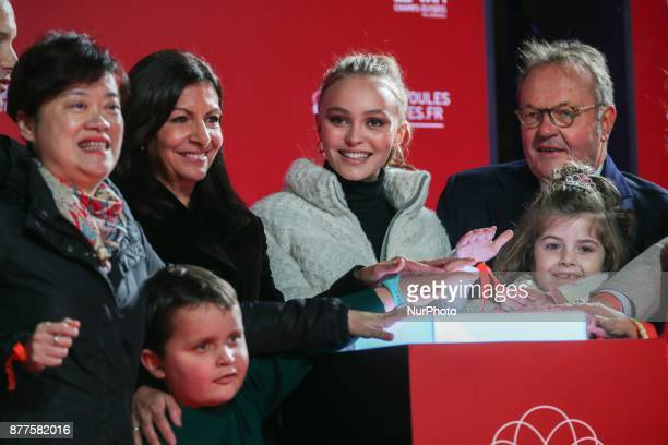 Paris Mayor Anne Hidalgo FrenchAmerican actress and model LilyRose Depp and the president of the ChampsElysees Committee JeanNoel Reinhardt...