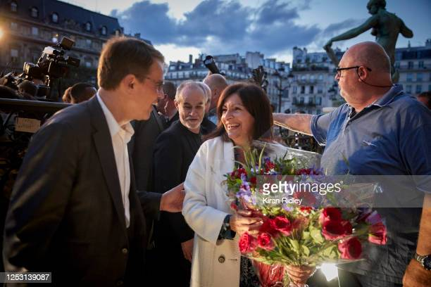Paris Mayor Anne Hidalgo is congratulated outside Hotel de Ville after declaring victory in her bid for reelection as Mayor of Paris on June 28 2020...