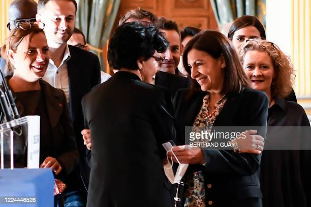 Paris' Mayor Anne Hidalgo is welcomed by member of the French rightwing Les Republicains party and former candidate for the Paris 2020 mayoral...