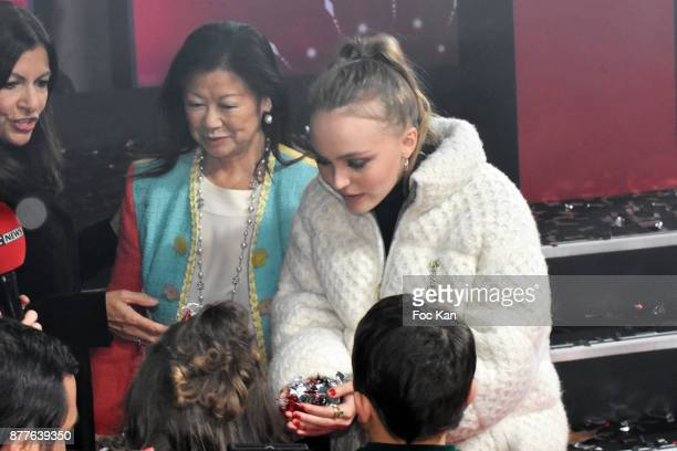 Paris Mayor Anne Hidalgo kids from 'Les Petits Princes' Children care association mayor of 8th district Jeanne d'Hauteserre and Lily Rose Depp attend...