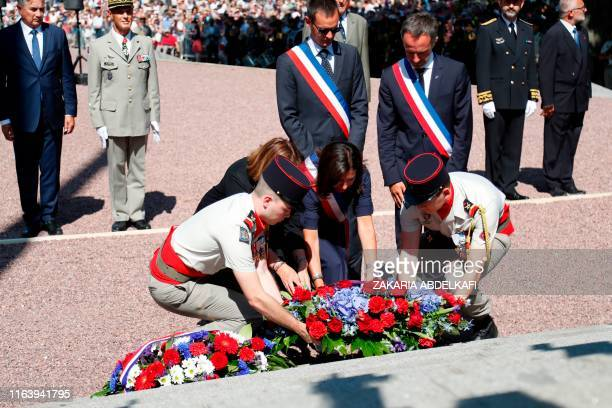 Paris Mayor Anne Hidalgo lays a wreath of flowers at the foot of the statue of French Marshal Philippe Leclerc de Hauteclocque during a ceremony in...