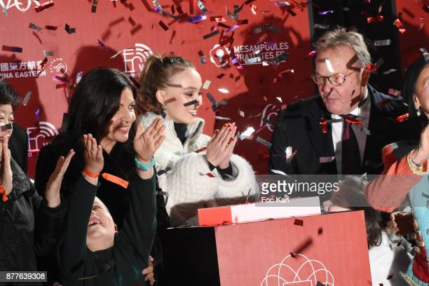 Paris Mayor Anne Hidalgo Lily Rose Depp and Jean Noel Reinhardt President of Champs Elysees Comiteeattend Christmas Lights Launch On The Champs...
