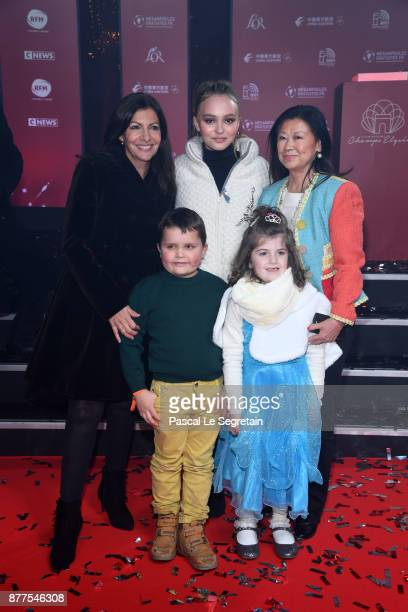 Paris Mayor Anne Hidalgo Lily Rose Depp and Jeanne d'Hauteserre attend the Christmas Lights Launch on November 22 2017 in Paris France