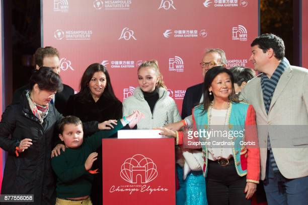 Paris Mayor Anne Hidalgo Lily Rose Depp and Jeanne d'Hauteserre attend the Christmas Lights Launch On The Champs Elysees on November 22 2017 in Paris...
