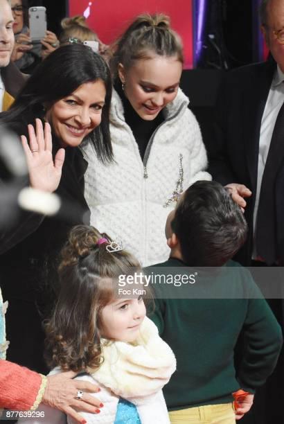 Paris Mayor Anne Hidalgo Lily Rose Depp kids from 'Les Petits Princes' Children care association and Jean Noel Reinhardt President of Champs Elysees...