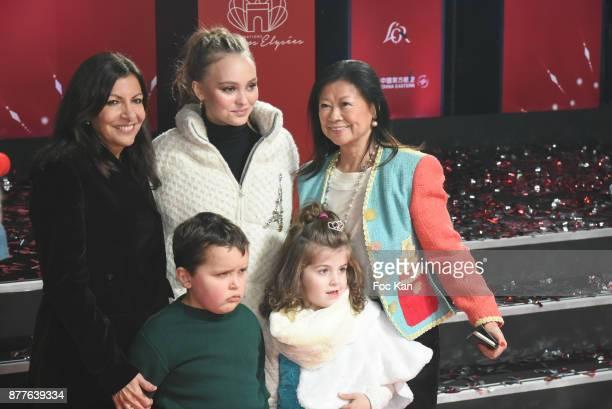 Paris Mayor Anne Hidalgo Lily Rose Depp kids from 'Les Petits Princes' Children care association and Jeanne d'Hauteserre attend Christmas Lights...