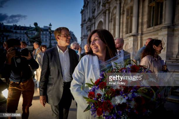 Paris Mayor Anne Hidalgo looks towards supporters as she enters the Hotel de Ville after declaring victory in her bid for reelection as Mayor of...