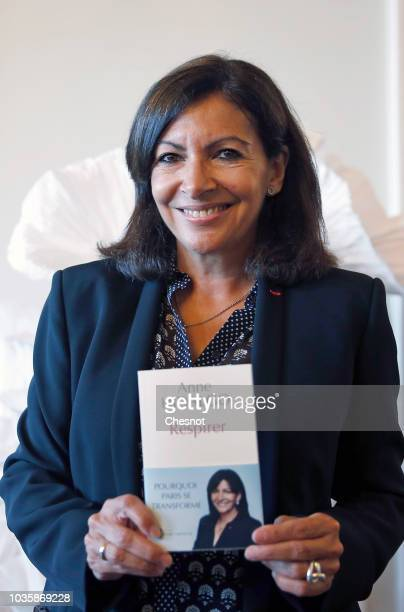 Paris Mayor Anne Hidalgo poses with her book Breathe during the European Lung Foundation award ceremony on September 19 2018 in Paris France On...