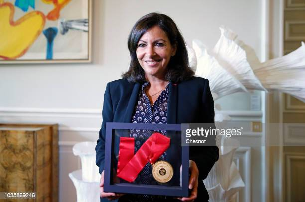 Paris Mayor Anne Hidalgo poses with the award of the European Lung Foundation at the Paris city hall on September 19 2018 in Paris France On occasion...