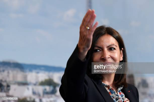 Paris' Mayor Anne Hidalgo reacts during a Paris council meeting on July 3 2020 at the Paris city hall as she arrives on stage following her official...