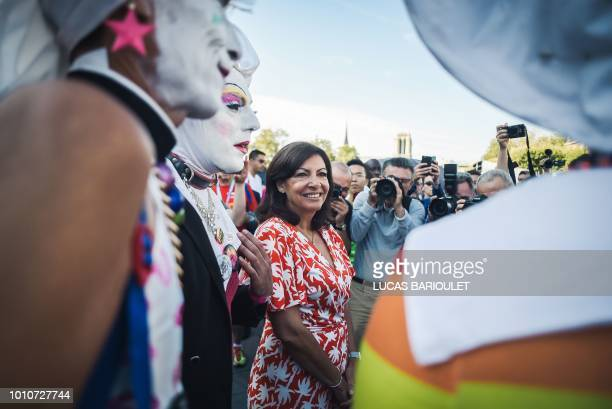 Paris mayor Anne Hidalgo smiles as she visits the installations during the inauguration of the sport village of the 2018 Gay Games' edition on the...