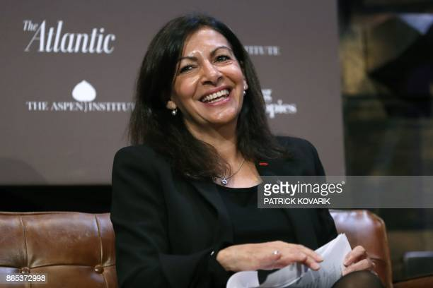 Paris mayor Anne Hidalgo smiles during the C40 Cities Climate Summit in Paris on October 23 2017 / AFP PHOTO / PATRICK KOVARIK