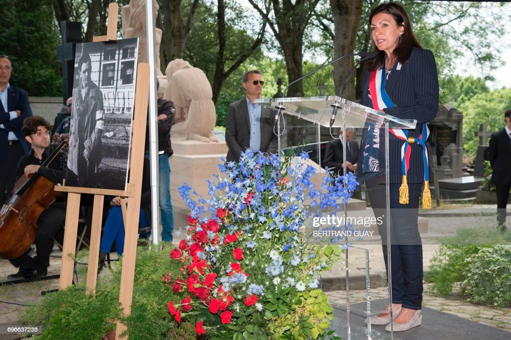 Paris mayor Anne Hidalgo speaks during a ceremony as the body of Spanish republican survivor of Austrian Mauthausen concentration camp Francesc Boix i Campo is transferred at the Pere Lachaise cemetery in Paris on June 16, 2017. /