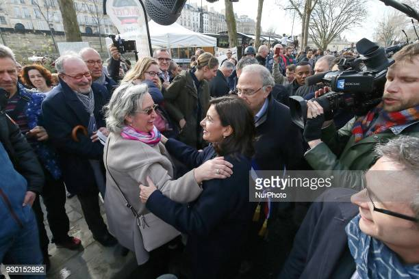 Paris' mayor Anne Hidalgo takes part in a demonstration on March 10 2018 on the Seine river banks in central Paris to keep as pedestrian zones the...