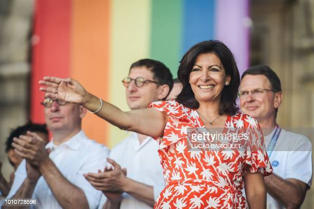 Paris mayor Anne Hidalgo waves as she arrives on stage to deliver a speech during the inauguration of the sport village of the 2018 Gay Games'...