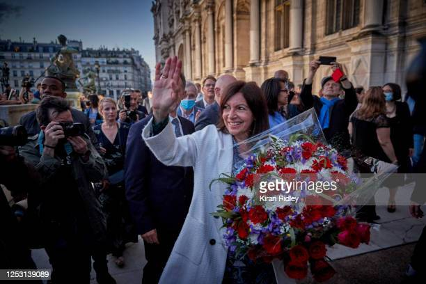 Paris Mayor Anne Hidalgo waves to supporters outside Hotel de Ville after declaring victory in her bid for reelection as Mayor of Paris on June 28...
