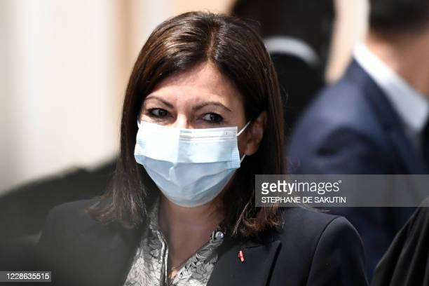 "Paris mayor Anne Hidalgo, wearing a protective face mask, arrives for a hearing at the ""Tribunal de Paris"" courthouse in Paris, on September 21 as..."