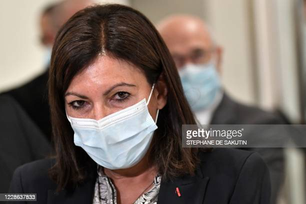 "Paris mayor Anne Hidalgo, wearing a protective face mask, looks on at the ""Tribunal de Paris"" courthouse in Paris, on September 21 as part of the..."