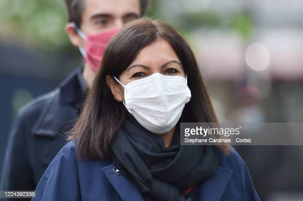 Paris Mayor Anne Hidalgo wearing a protective facemask arrives to inaugurate a public hydroalcoholic gel dispenser installed on a bus shelter on May...