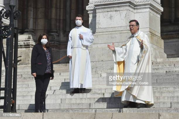 Paris Mayor Anne Hidalgo wearing a protective mask and Paris Archbishop Michel Aupetit during the Holy Thursday celebration at the SacreCoeur...