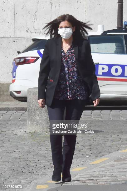 Paris Mayor Anne Hidalgo wearing a protective mask arrives to the Holy Thursday celebration at the SacreCoeour basilica during the coronavirus crisis...