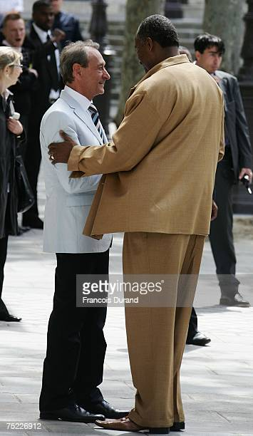 Paris Mayor Bertrand Delanoe greats Tony Paker's father as they arrive at the townhall to celebrate Eva Longoria and Tony Parker's civil wedding on...
