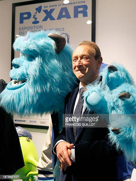 Paris mayor Bertrand Delanoe poses with a muppet of Pixar's film 'Monsters and Cie' character 'Sulli' during the inauguration of the exhibition...