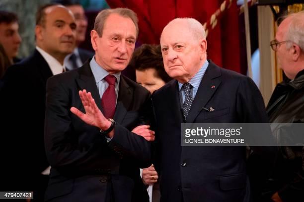 Paris mayor Bertrand Delanoe speaks with French businessman Pierre Berge during a ceremony dedicated to the bestowing of 'Grand officier de la Legion...