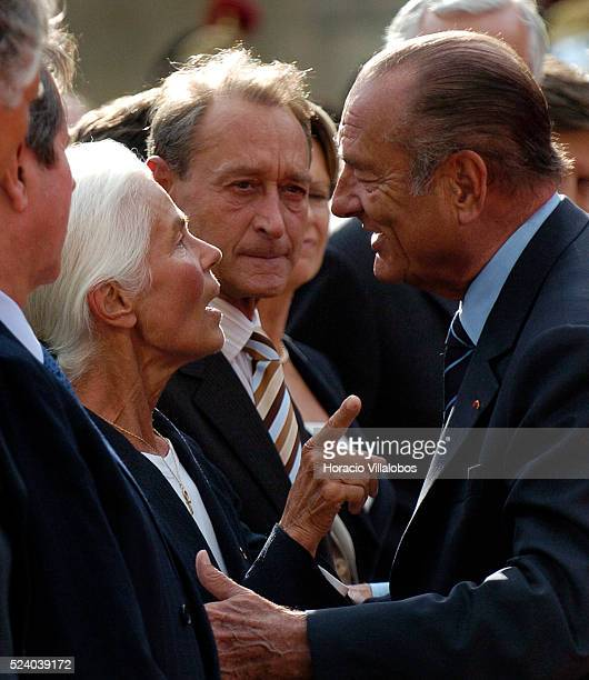Paris Mayor Bertrand Delanoe watches as French President Jacques Chirac talks to Micheline ChabanDelmas third wife of Jacques Chaban Delmas during...