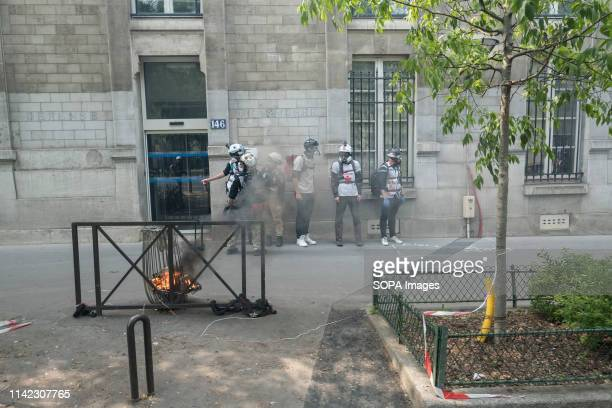 Paris Medics are seen stand by the side as the May Day protests turn violent in Paris May Day is a public holiday celebrated normally on 1 May The...