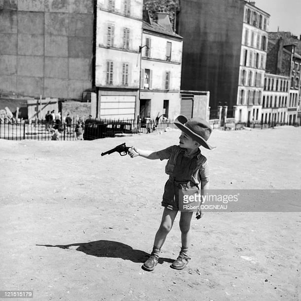 Paris Menilmontant Boy Playing Cowboy In A Wasteland
