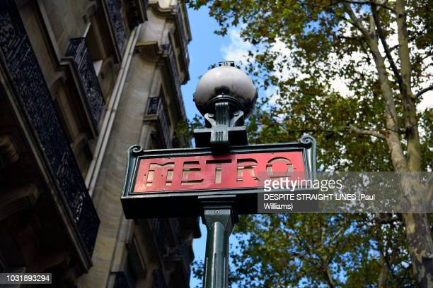 paris metro (maubert-mutualite) off boulevard saint-germain (colour version) - paris metro sign stock pictures, royalty-free photos & images