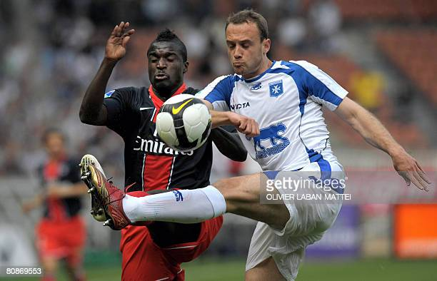 Paris' midfielder Bernard Mendy vies with Auxerre's defender JeanPascal Mignot during the French L1 football match Paris vs Auxerre on April 26 2008...