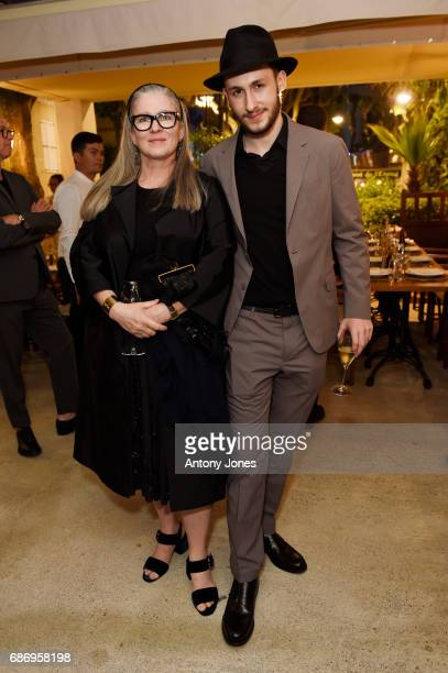 Paris Murray and Argento Celant attend Fondazione Prada Private Dinner during the 70th annual Cannes Film Festival at Restaurant Fred L'Ecailler on...
