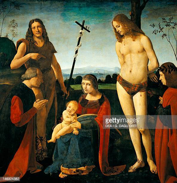 Paris Musée Du Louvre Casio Altarpiece Madonna with Child the Baptist St Sebastian and two donors from the Casio family by Giovanni Antonio...