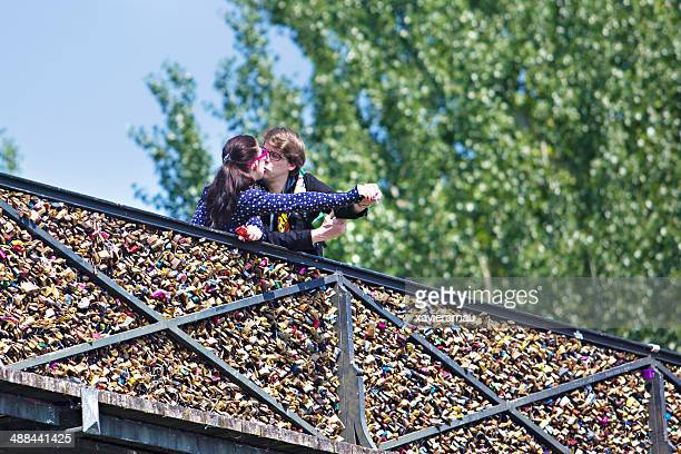 paris mon amour - chest kissing stock photos and pictures