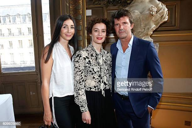 Paris National Opera dance director Aurelie Dupont standing between PaulEmmanuel Reiffers and his wife Margaux attend Cyril Karaoglan receives the...