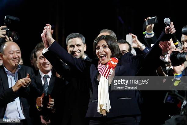 Paris' newlyelected mayor Anne Hidalgo celebrates in front of the City Hall of Paris after she won the second round of the French municipal elections...
