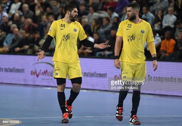 Paris' Nikola Karabatic and Paris' Luka Karabatic speaks during the French D1 handball match between Montpellier and Paris at Sud de France Arena on...