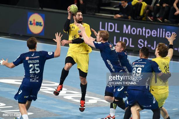 Paris' Nikola Karabatic passes the ball during the French D1 handball match between Montpellier and Paris at the Sud de France Arena hall on December...