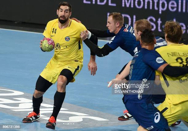 Paris' Nikola Karabatic vies with Montpellier's Valentin Porte during the French D1 handball match between Montpellier and Paris at Sud de France...