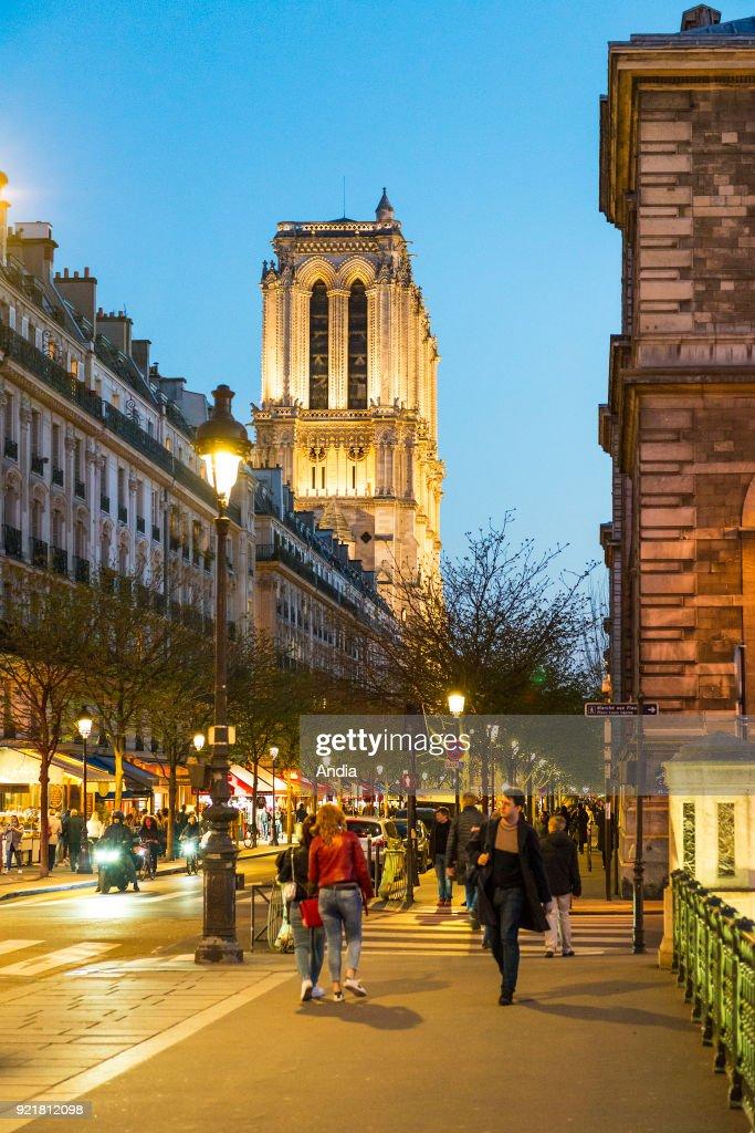 Notre-Dame de Paris and the street 'rue d'Arcole' on the Ile de la Cite, in the 4th arrondissement (district).