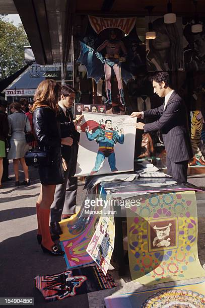 Paris November 1967 Venue of the United States fashion posters arrived in France Here a street merchant offers a poster of Superman has a client