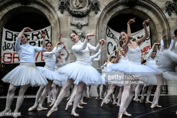 Paris Opera dancers perform in front of the Palais Garnier against the French government's plan to overhaul the country's retirement system in Paris...