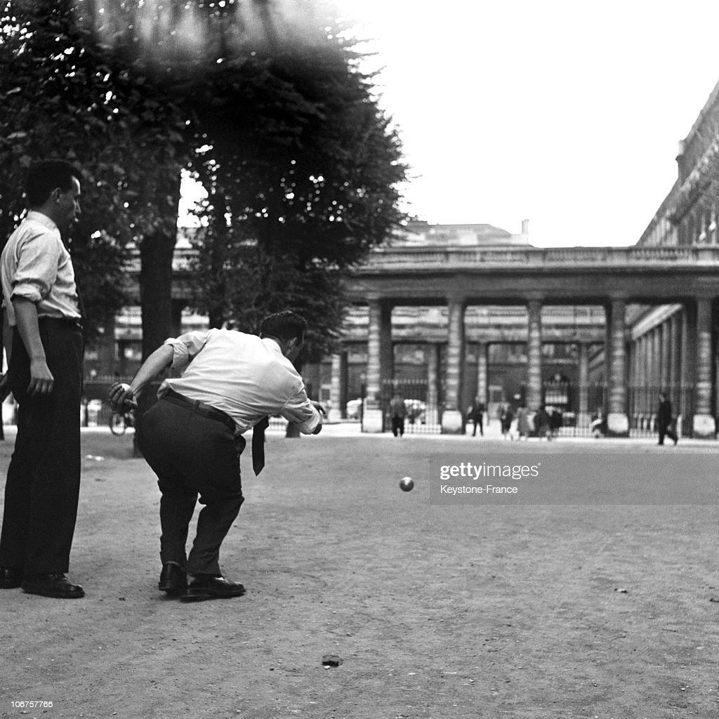 Paris, Palais Royal Garden. A Traditional Petanque Game In 1956. : News Photo