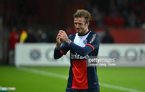 Paris SaintGermain's celebrates with Paris SaintGermain's English midfielder David Beckham after scoring during a French L1 football match between...