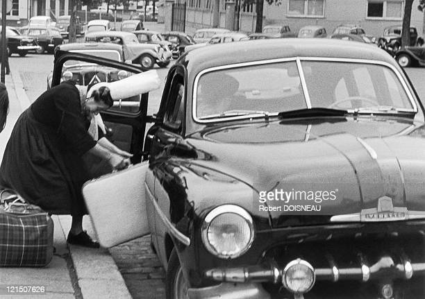 Paris Place Bienvenue A Bigouden Woman Getting In A Car With Her Luggage